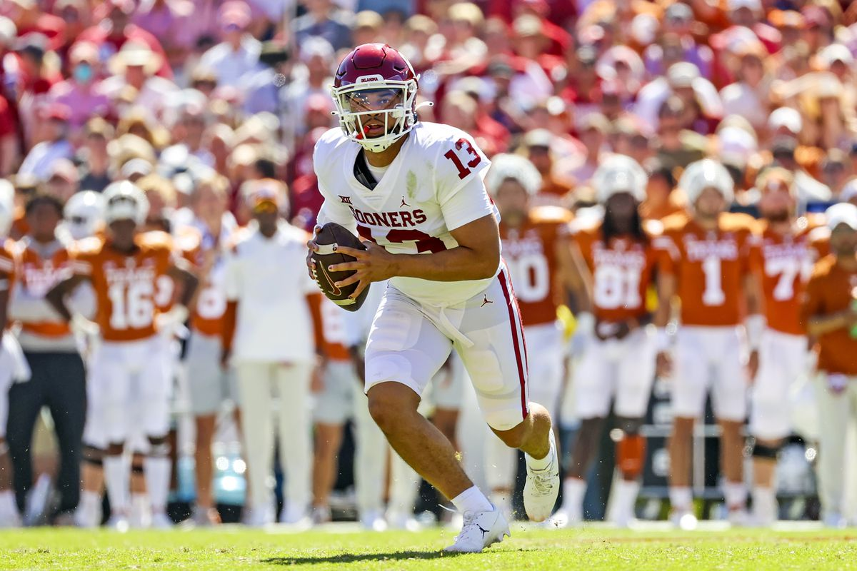 Oklahoma Sooners quarterback Caleb Williams (13) throws during the second half against the Texas Longhorns at the Cotton Bowl.
