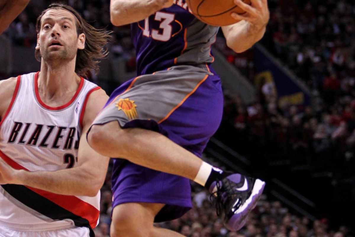 PORTLAND OR - OCTOBER 26:  Steve Nash #13 of the Phoenix Suns drives with the ball agianst the Portland Trail Blazers on October 26 2010 at the Rose Garden in Portland Oregon.  (Photo by Jonathan Ferrey/Getty Images)