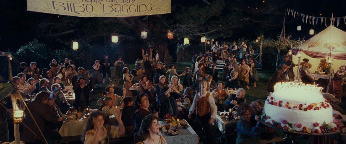 hobbits celebrate bilbo's birthday in hobbiton in lord of the rings