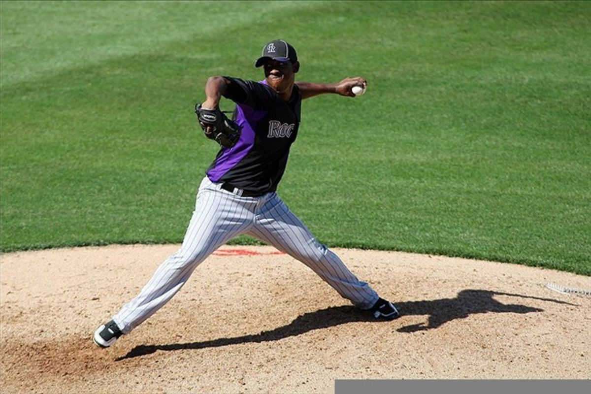 Mar 14, 2012; Surprise, AZ, USA; Colorado Rockies starting pitcher Edwar Cabrera (74) pitches against the Texas Rangers during the fifth inning at Surprise Stadium.  Mandatory Credit: Jake Roth-US PRESSWIRE
