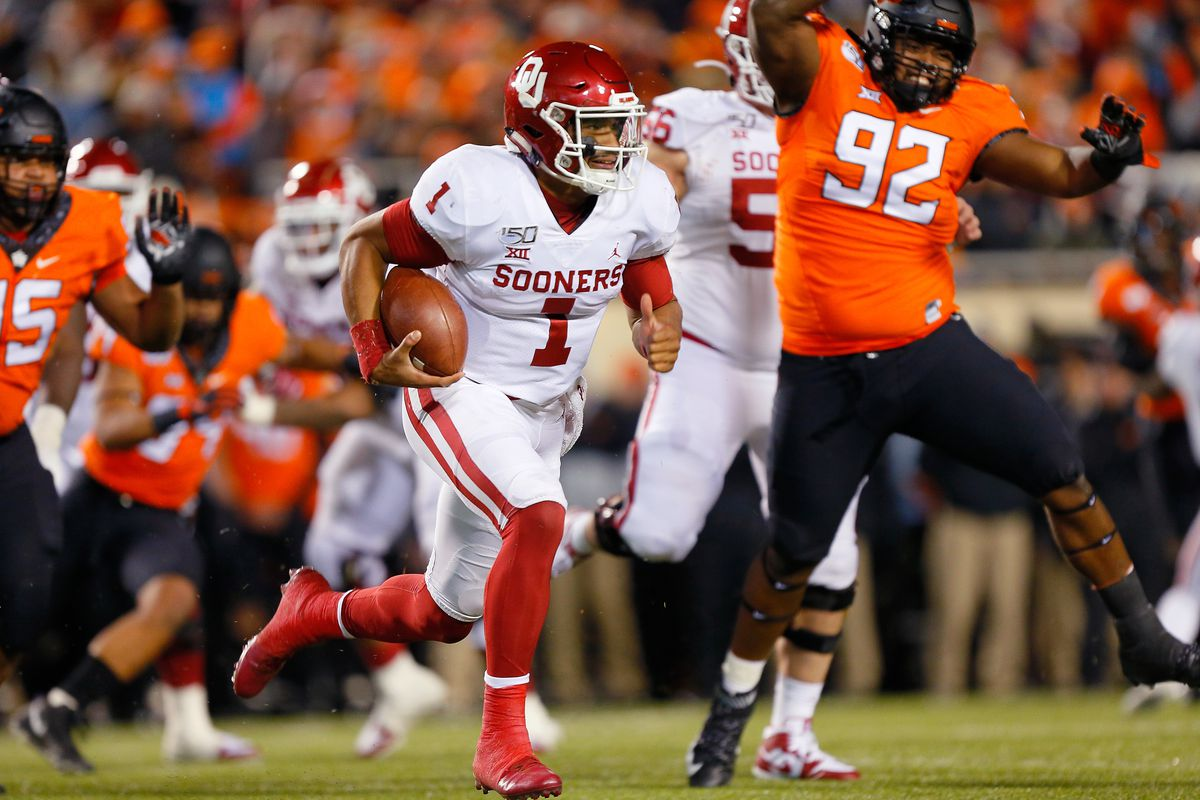 Quarterback Jalen Hurts of the Oklahoma Sooners runs the ball against defensive tackle Cameron Murray of the Oklahoma State Cowboys late in the third quarter on November 30, 2019 at Boone Pickens Stadium in Stillwater, Oklahoma. OU won 34-16.