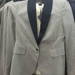 Women's seersucker blazer, $150 {from $475)