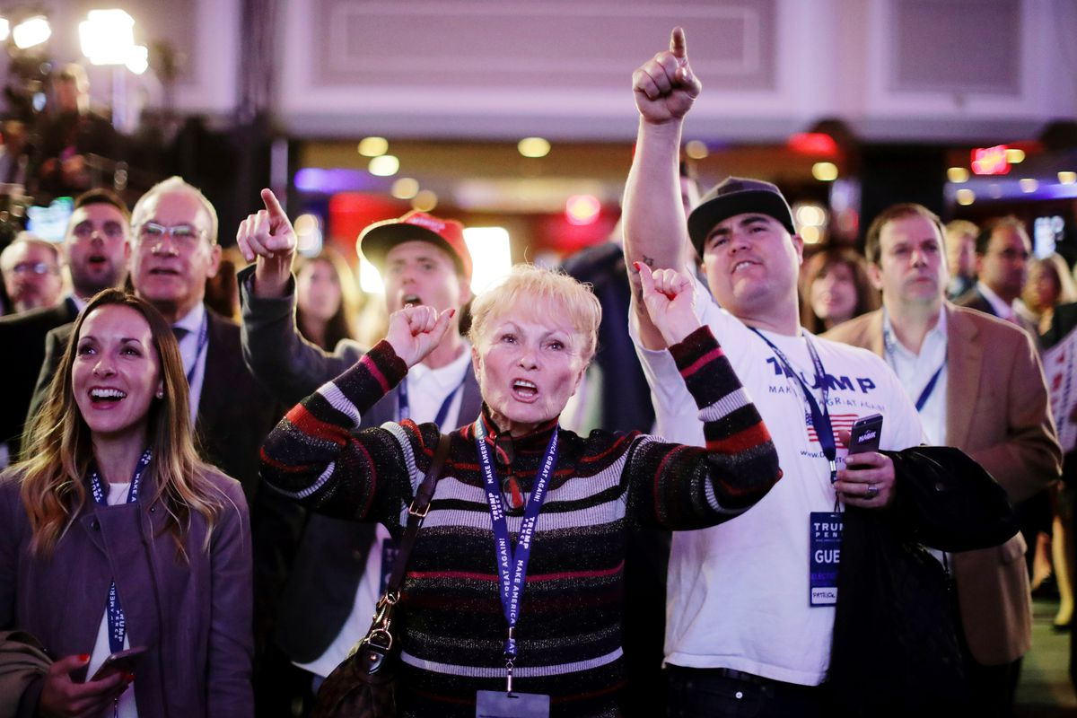 Carol Minor (C) along with other supporters of Republican presidential nominee Donald Trump cheer during the election night event at the New York Hilton Midtown on November 8, 2016 in New York City.
