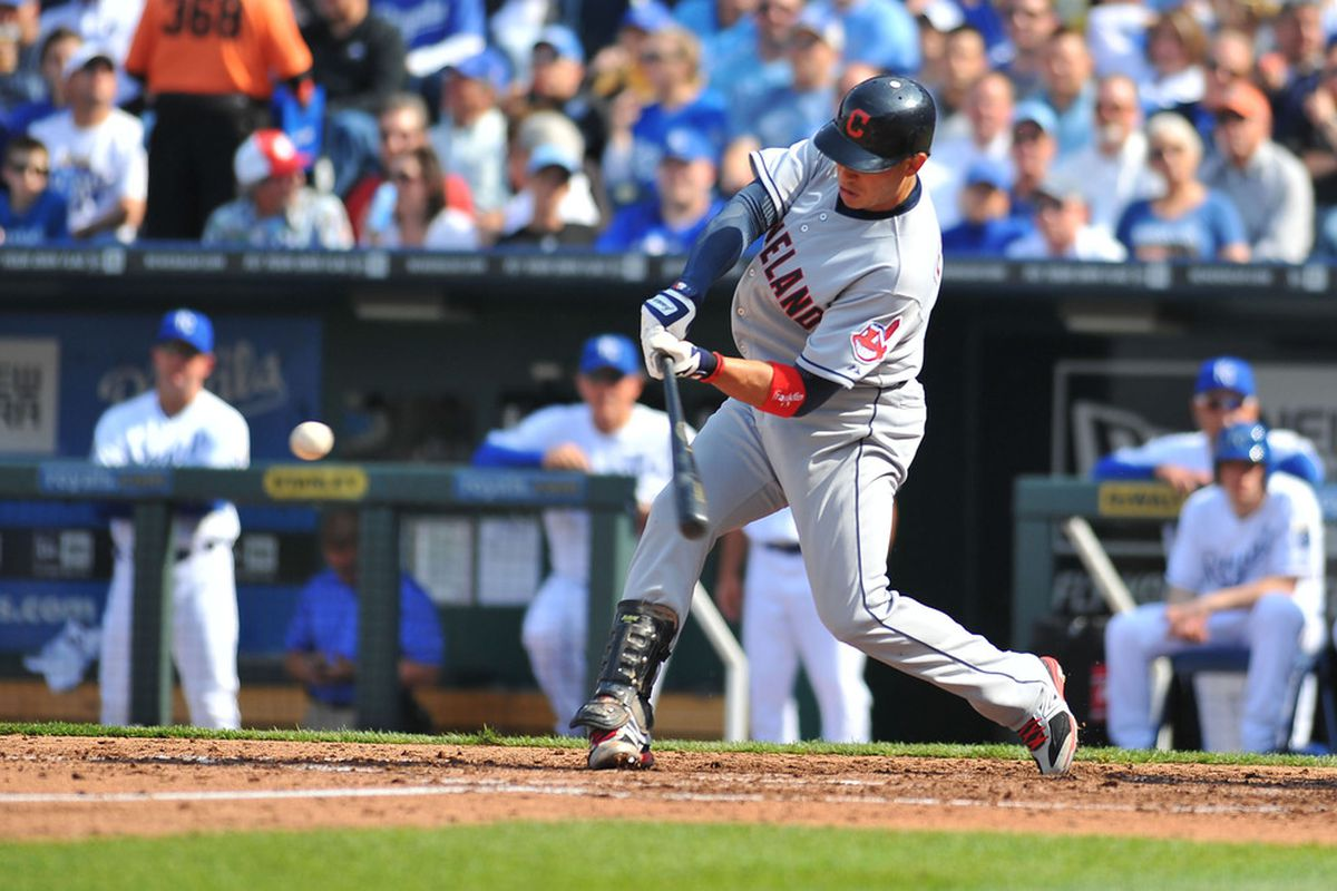 April 13, 2012; Kansas City, MO, USA; Cleveland Indians shortstop Asdrubal Cabrera (13) connects for a single in the fourth inning against the Kansas City Royals at Kauffman Stadium. The Indians won 8-3.Mandatory Credit: Denny Medley-US PRESSWIRE