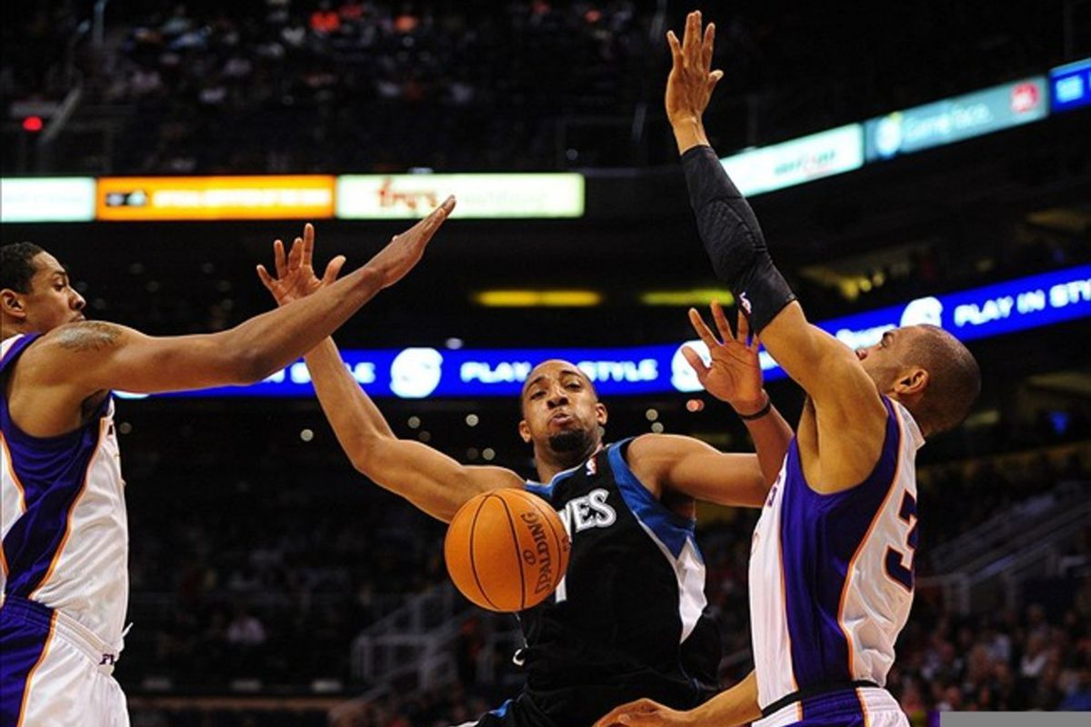 Mar. 1, 2012; Phoenix, AZ, USA; Minnesota Timberwolves forward (7) Derrick Williams loses the ball as he is fouled by the Phoenix Suns in the first half at the US Airways Center. Mandatory Credit: Mark J. Rebilas-US PRESSWIRE