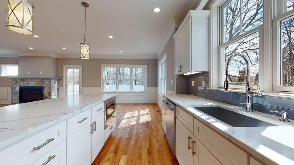 An open kitchen with a counter and an island.
