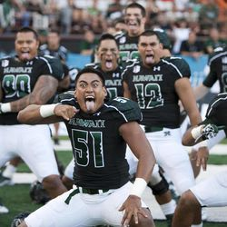 """Hawaii linebacker Lance Williams, center, and his teammates perform a """"haka"""" before the start of the NCAA college football game against Lamar on  Saturday, Sept. 15, 2012, in Honolulu."""