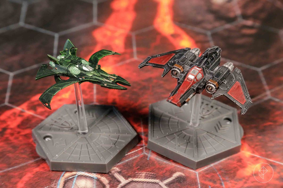 A nightwing in green and a Xiphon interceptor done up like a 30K Dark Angels fighter.