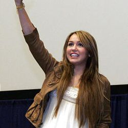 """Miley Cyrus waves to the crowd Friday at a premiere of her movie """"Hannah Montana,"""" at the Megaplex 20 in South Jordan."""