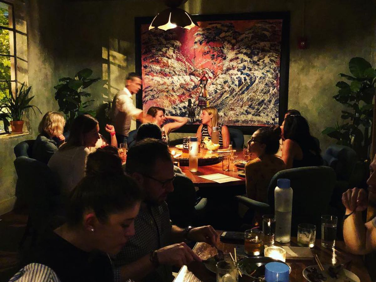 Crowd inside of a restaurant eating