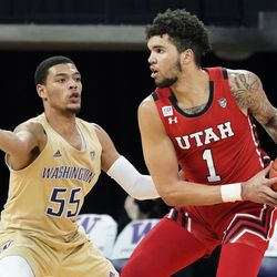 Utah forward Timmy Allen (1) tries to get around Washington guard Quade Green (55) during the first half of an NCAA college basketball game, Sunday, Jan. 24, 2021, in Seattle.