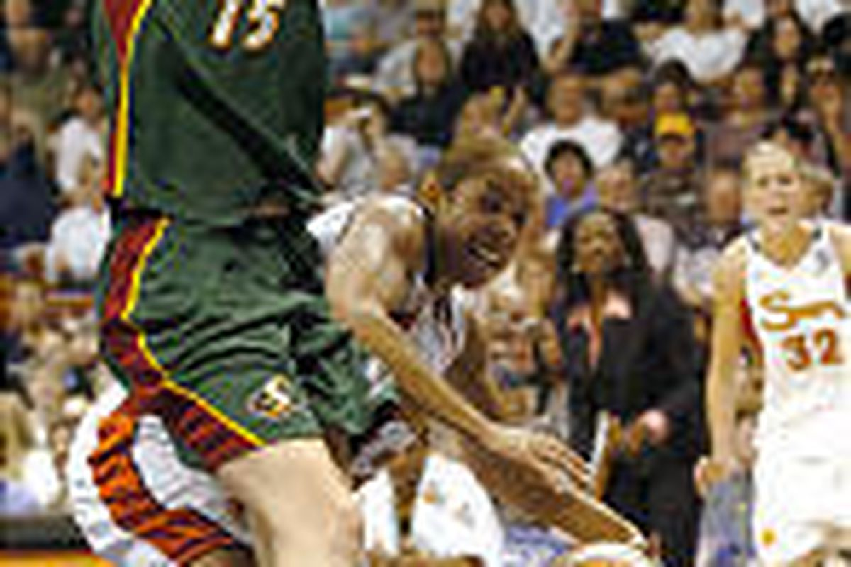 The Sun's Nykesha Sales passes the ball around Seattle's Lauren<BR>   Jackson (15) in the first half of Friday's WNBA Finals game.