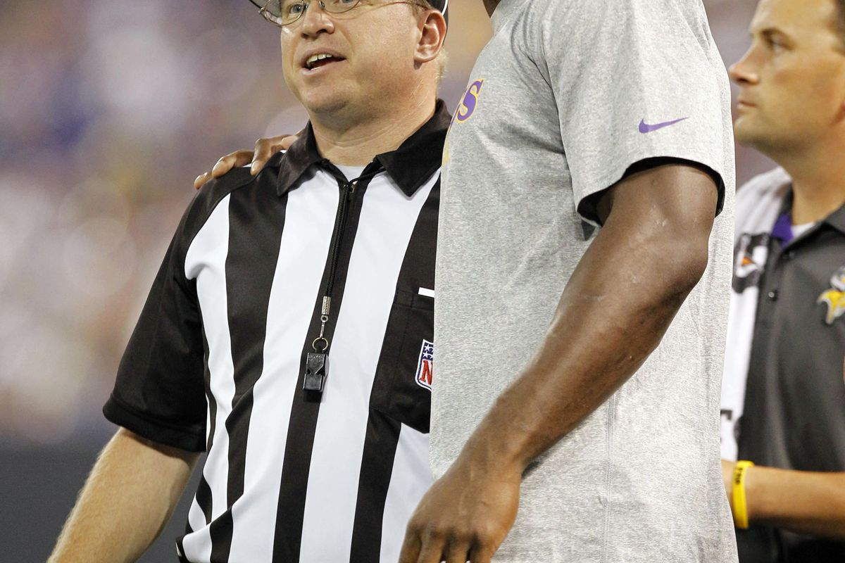 """It LOOKS like AP is being chummy and all here with the replacement ref, but what he's really saying is """"call a clean game dude or I'll squeeze my arm and pop your head off like a high school zit. Now let's smile and laugh for the cameras...""""."""