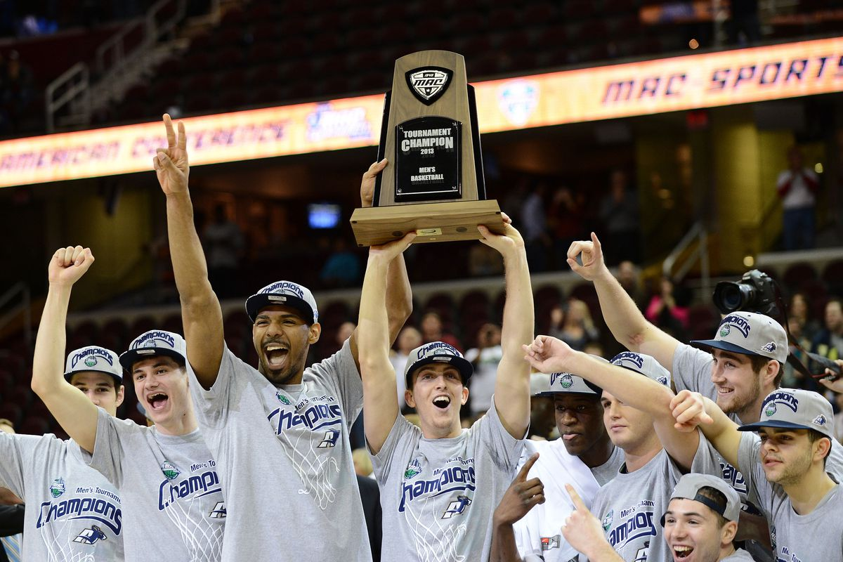 Akron's Brian Walsh holds up the MAC Championship Trophy