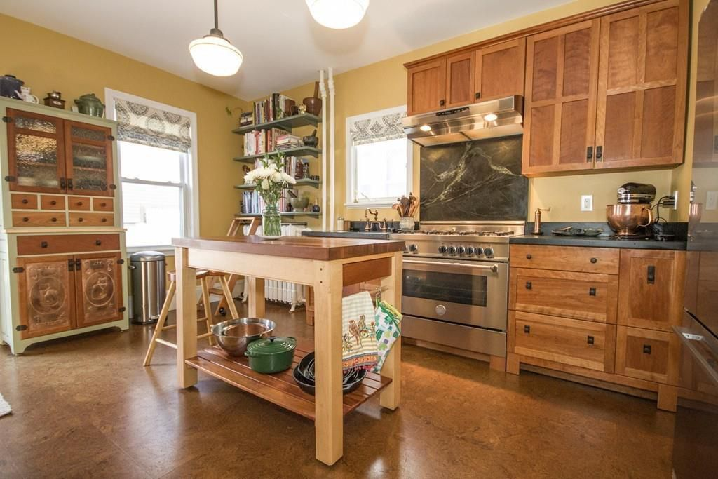 The same kitchen, but facing the island and the kitchen with cabinetry.