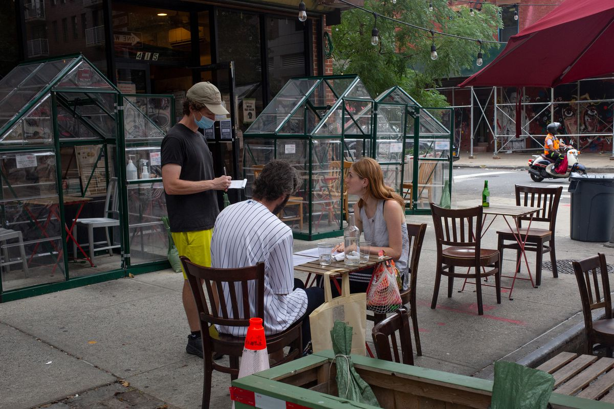 A waiter takes a couple's order at Peaches HotHouse in Bed-Stuy, Brooklyn, Sept. 16, 2021.