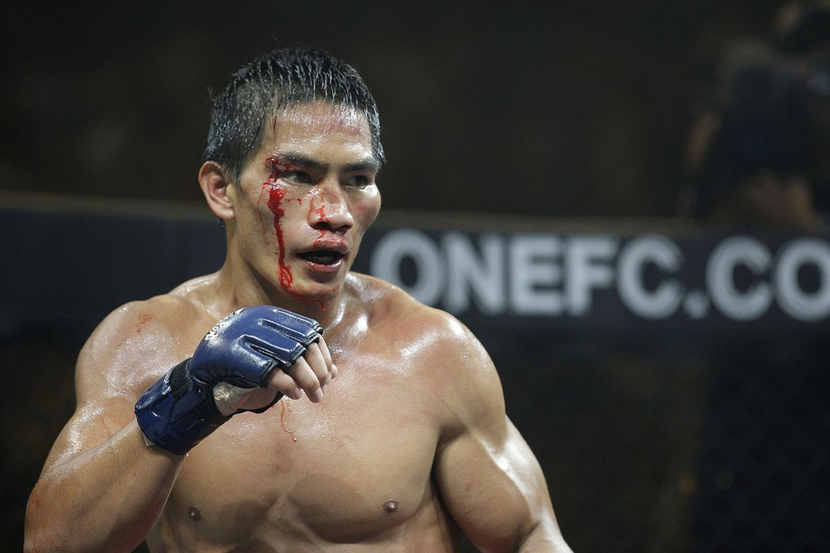 SINGAPORE - SEPTEMBER 03:Eduard Folayang in action during his lightweight bout against A Sol Kwon during the ONE Fighting Championships at Singapore Indoor Stadium on September 3, 2011 in Singapore.  (Photo by Suhaimi Abdullah/Getty Images)