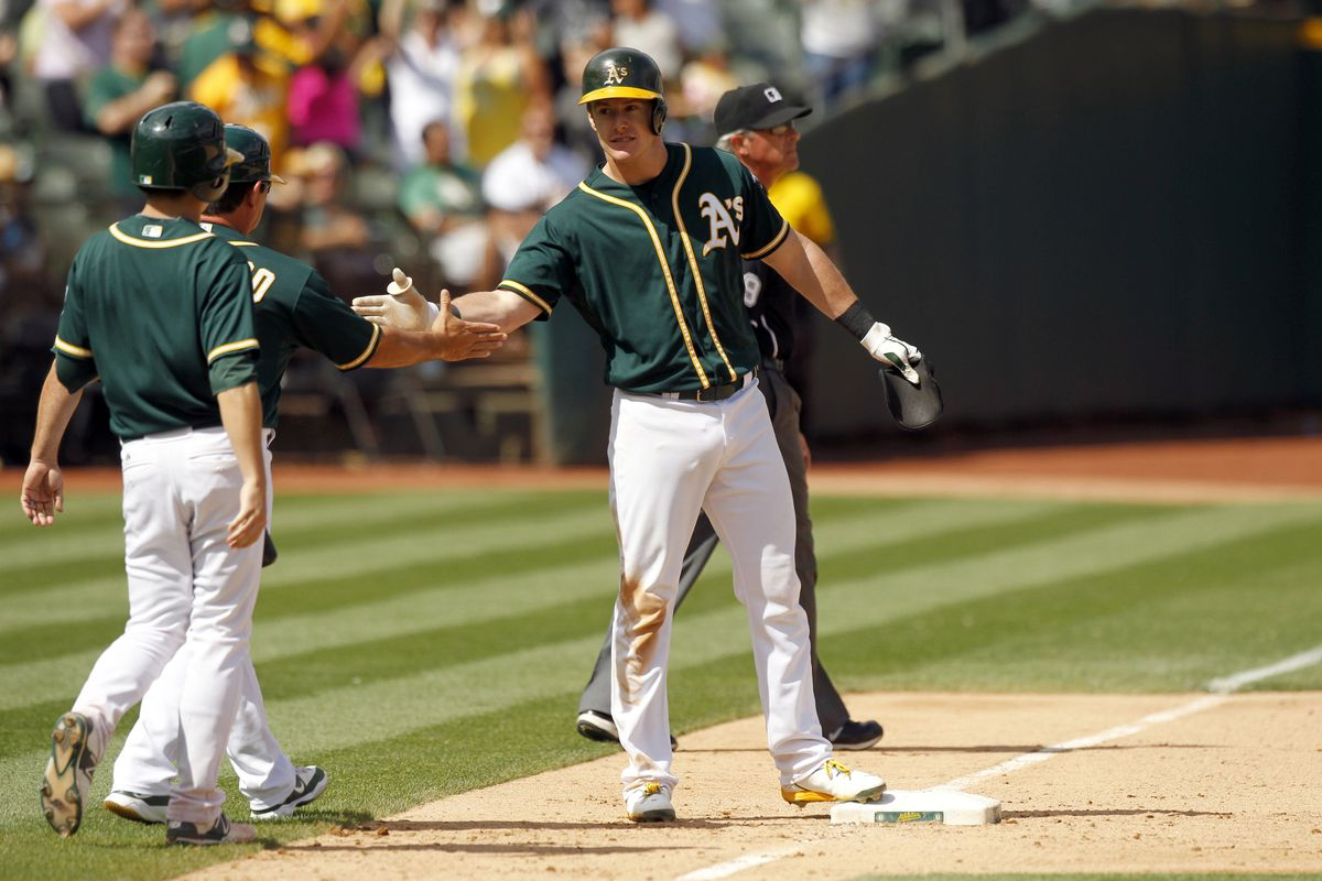Congratulated for his hot bat, Canha clears the bases and more!
