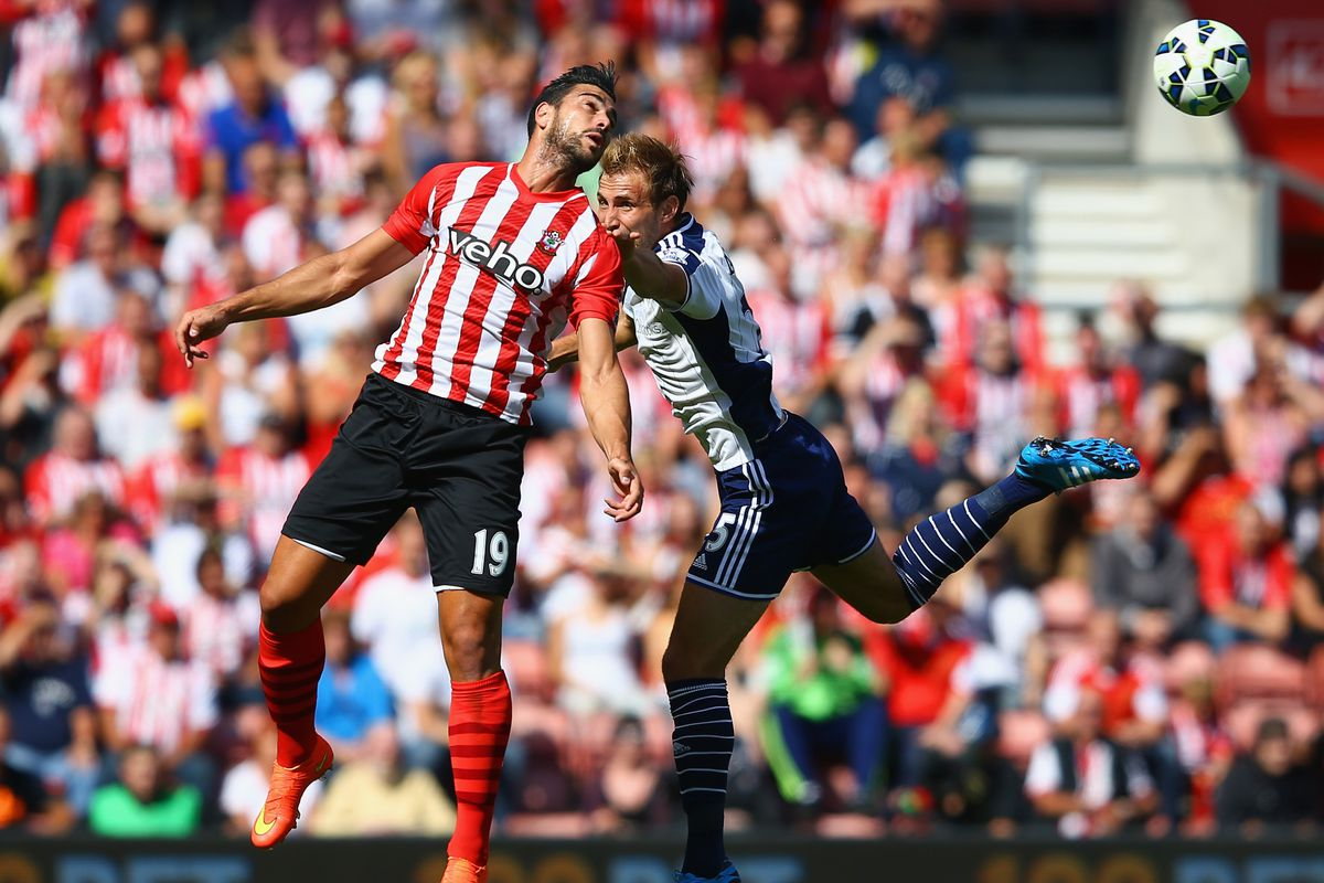 Italian frontman Graziano Pellè challenges for the ball on his competitive debut at St. Mary's