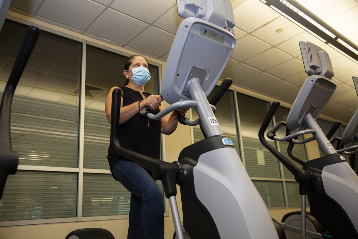 Breast cancer survivor Maria Jaramillo goes through her workout at Loyola University Medical Center in Maywood.