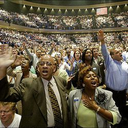 Members of the Lakewood Church in Houston rejoice during a 2005 service