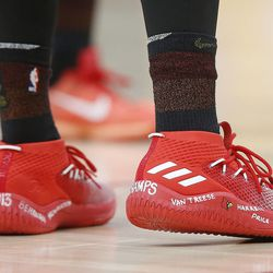 Utah Jazz guard Donovan Mitchell (45) has  messages written on his shoes in Salt Lake City on Friday, Feb. 23, 2018.