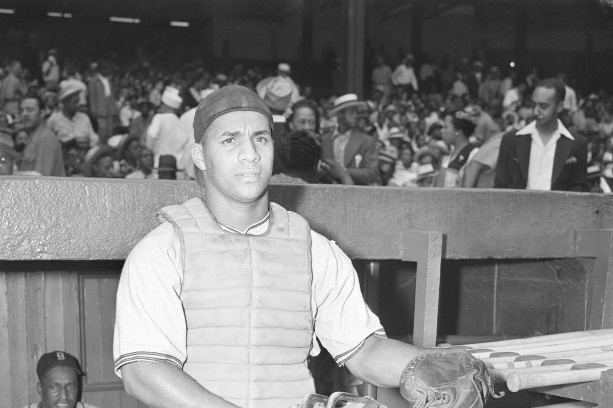 Roy Campanella Standing in a Dugout