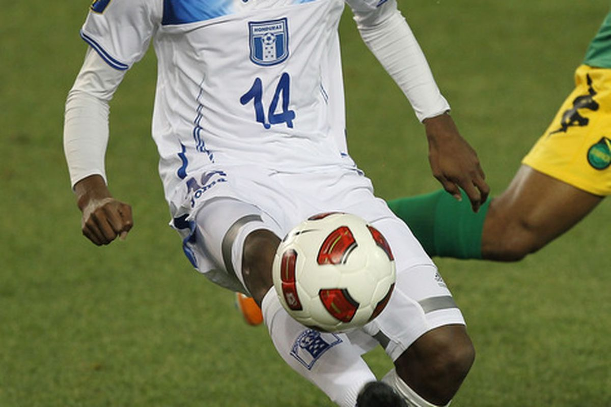 HARRISON, NJ - JUNE 13: Oscar Boniek Garcia #14 of Honduras kicks the ball against Jamaica during the Concaf Gold Cup at Red Bull Arena on June 13, 2011 in Harrison, New Jersey.  (Photo by Al Bello/Getty Images)