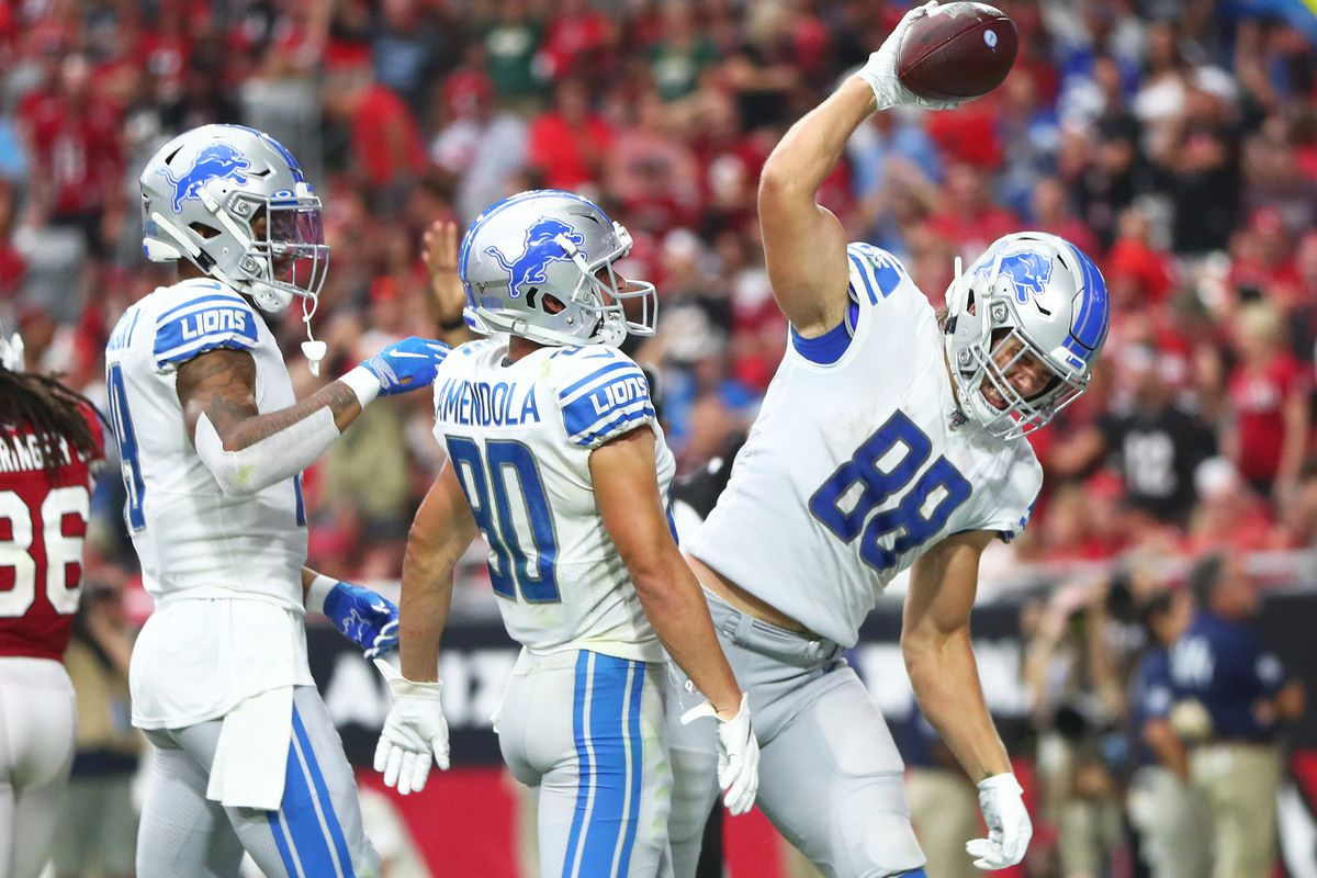 Detroit Lions tight end T.J. Hockenson spikes the ball after catching a touchdown pass in the fourth quarter against the Arizona Cardinals at State Farm Stadium.