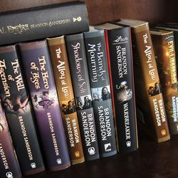 Books scribed by fantasy author Brandon Sanderson occupy a shelf at his home in American Fork on Thursday, Sept. 29, 2016. Sanderson has written over 40 fantasy books and is always working on his next book. He sold his first book in 2003 and now has books being enjoyed by readers around the world.