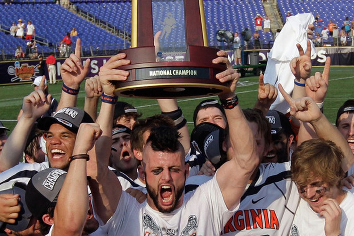 BALTIMORE, MD - MAY 30: Bray Malphrus #30 (C) of the Virginia Cavaliers holds up the trophy after they defeated the  Maryland Terrapins 9-7 at M&T Bank Stadium on May 30, 2011 in Baltimore, Maryland.  (Photo by Rob Carr/Getty Images)