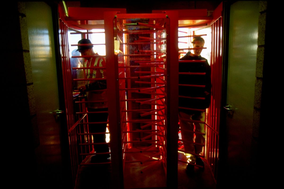 Fans go through the turnstiles