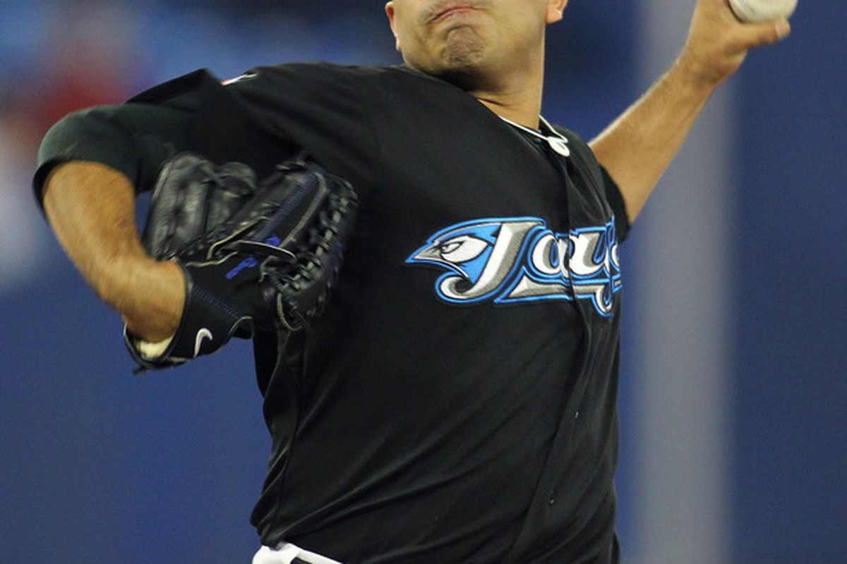 TORONTO,CANADA - SEPTEMBER 19:  Ricky Romero #24 of the Toronto Blue Jays delivers a pitch against the Los Angeles Angels of Anaheim in a MLB game on September 19, 2011 at the Rogers Centre in Toronto, Canada. (Photo by Claus Andersen/Getty Images)