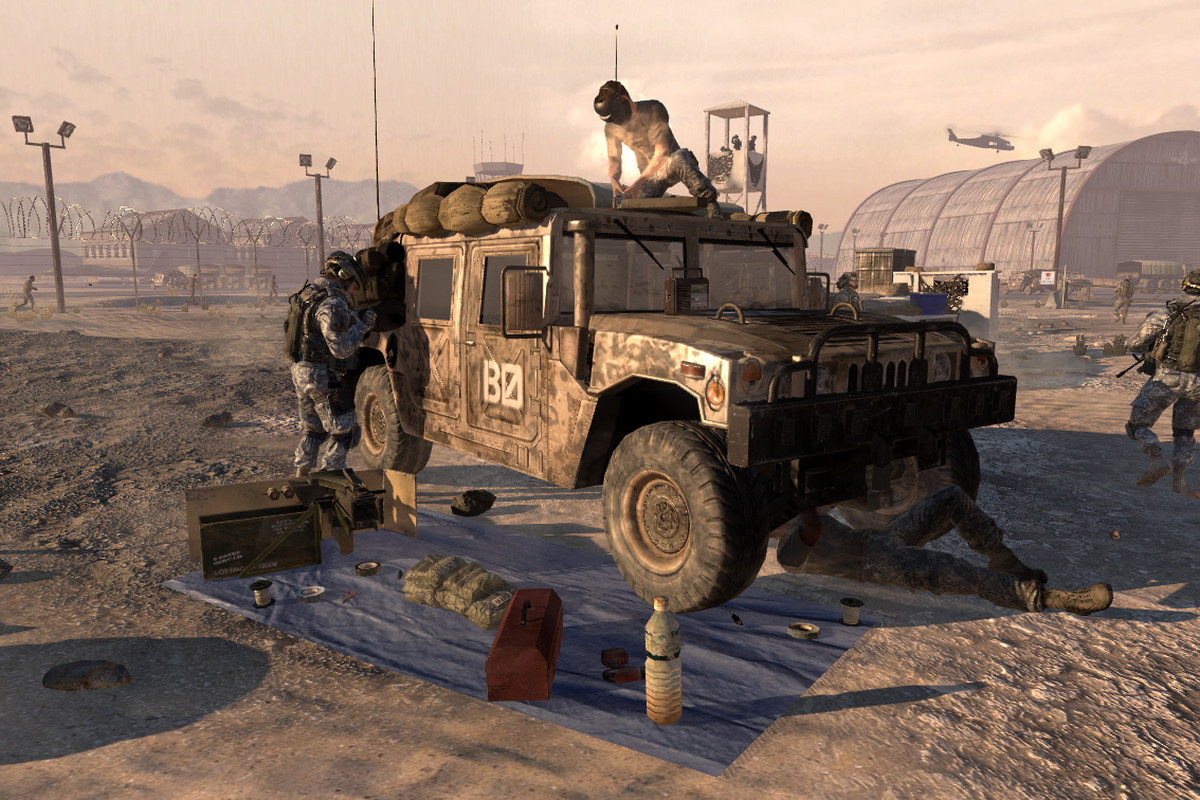 soldiers surround a humvee, working on repairs to it, in Call of Duty: Modern Warfare 2