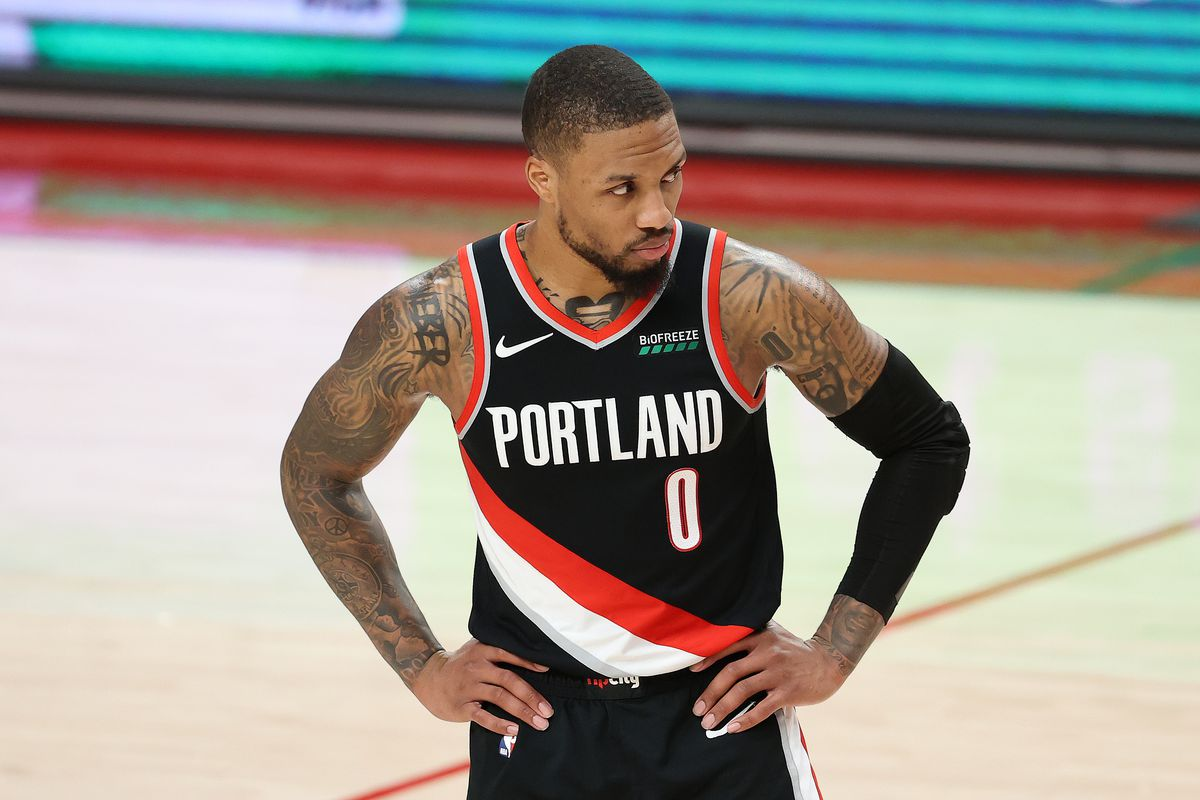 Damian Lillard of the Portland Trail Blazers reacts in the fourth quarter against the Washington Wizards at Moda Center on February 20, 2021 in Portland, Oregon.