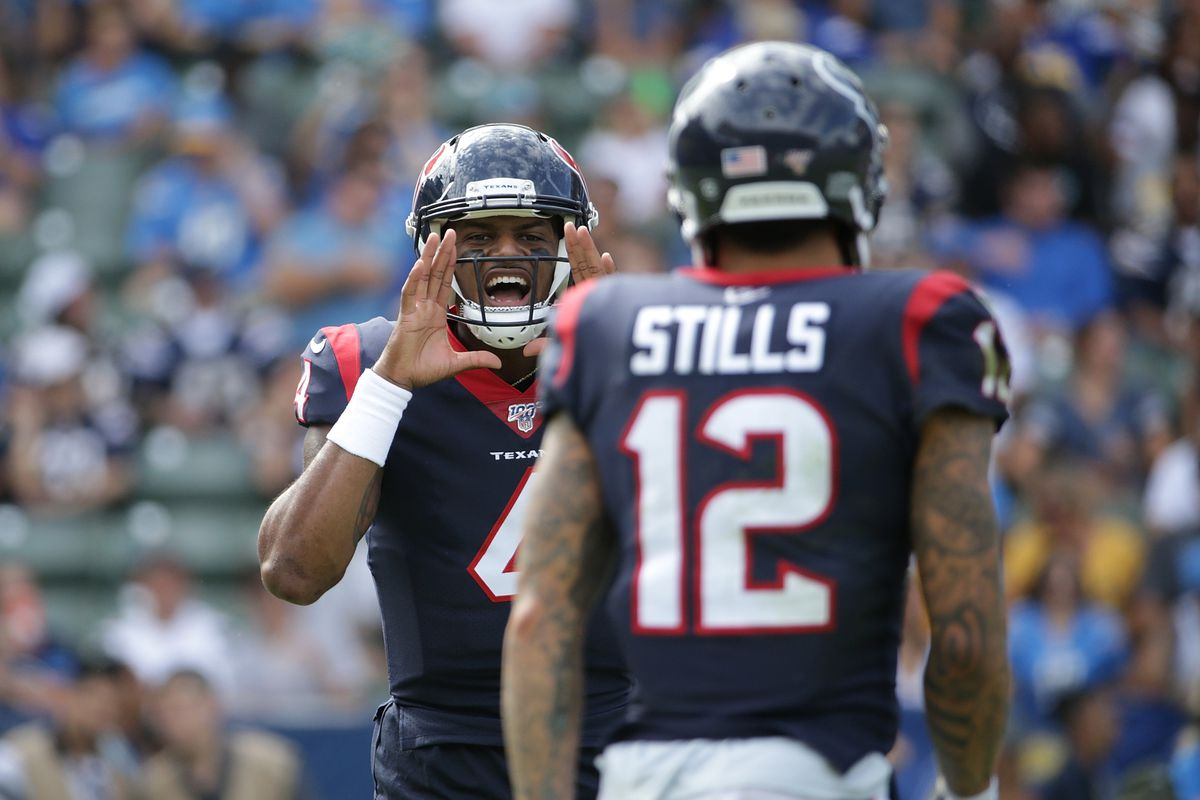 Deshaun Watson of the Houston Texans shouts instructions to Kenny Stills in the second quarter against the Los Angeles Chargers at Dignity Health Sports Park on September 22, 2019 in Carson, California.