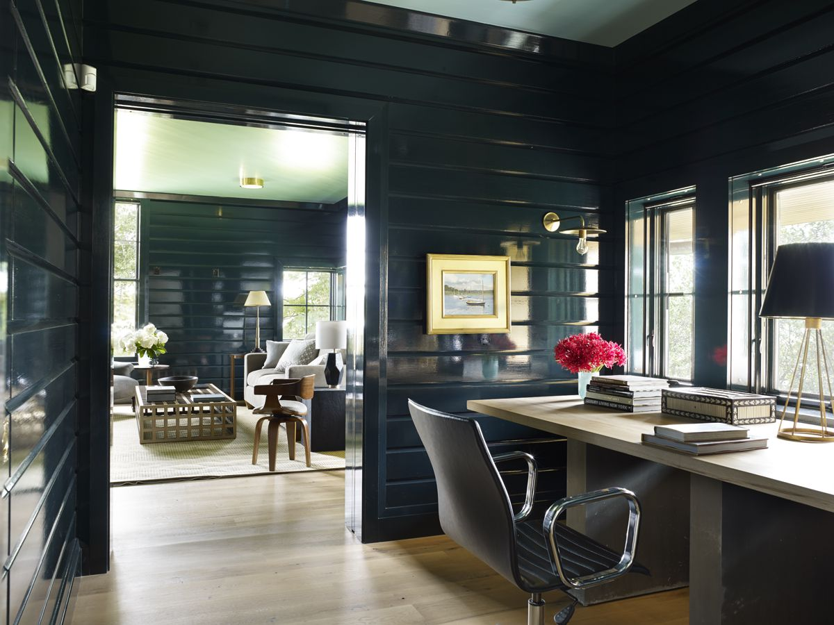 A pair of rooms are painted with a black with blue undertones.