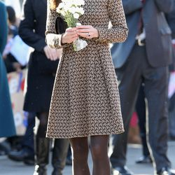 Kate visits The Rose Hill Primary School on February 21st, 2012 in a dress by Irish designer Orla Kiely and Aquatalia booties.