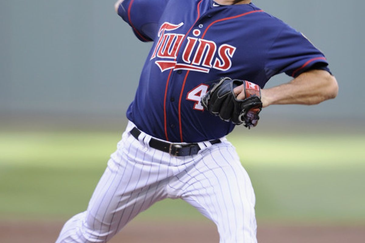 MINNEAPOLIS, MN - JUNE 13: Jeff Manship #49 of the Minnesota Twins delivers a pitch against the Philadelphia Phillies during the first inning on June 13, 2012 at Target Field in Minneapolis, Minnesota. (Photo by Hannah Foslien/Getty Images)