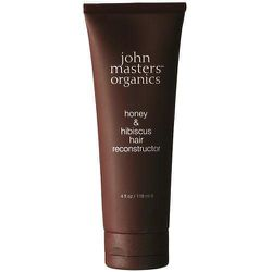 """In addition to honey and hibiscus, 16 certified organic ingredients go into John Masters Organics' <a href=""""http://www.jujusalon.com/product/honey-hibiscus-hair-reconstructor/"""">Honey & Hibiscus Hair Reconstructor</a> ($28). The once-weekly treatment's soy"""