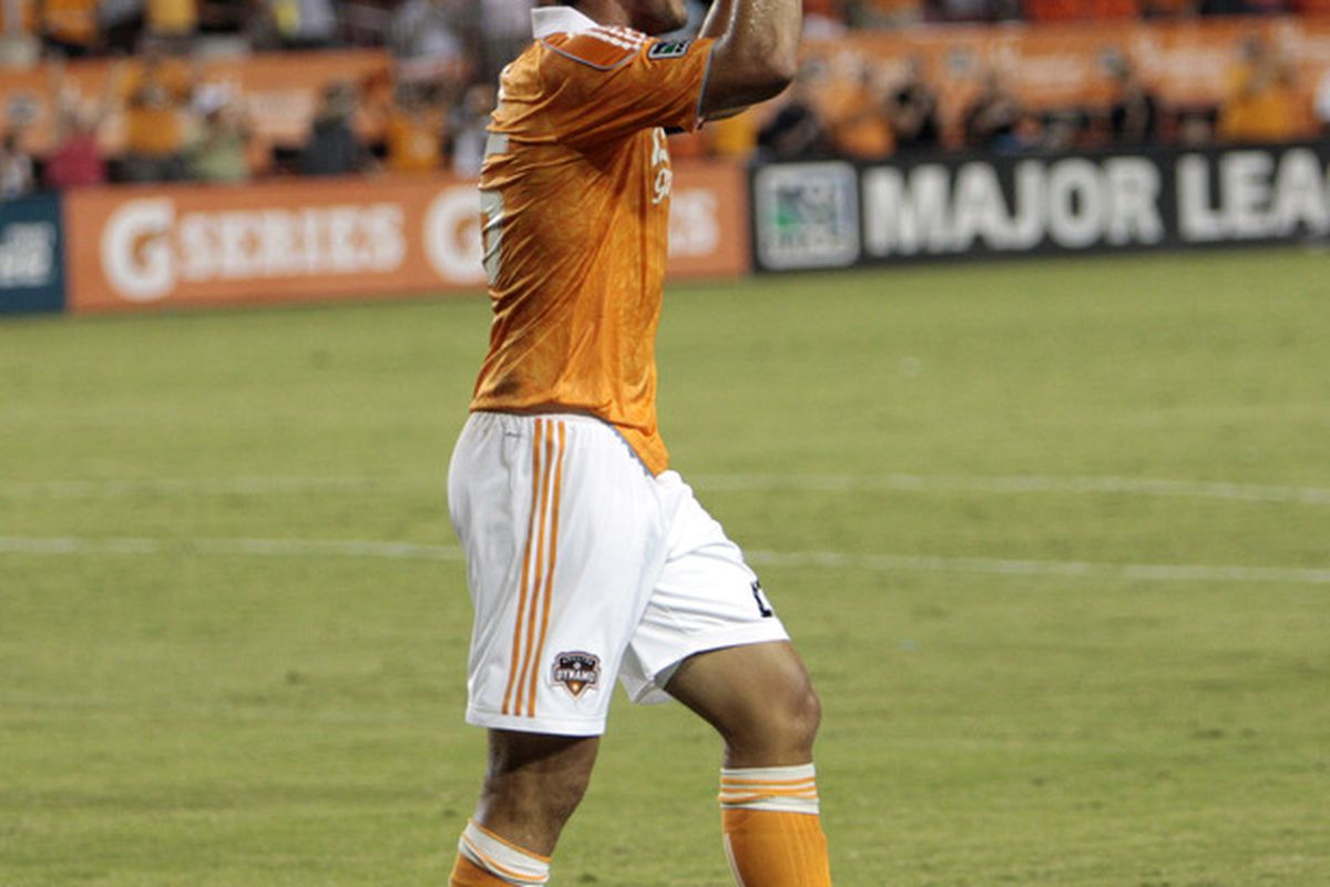HOUSTON - AUGUST 14:  Forward Brian Ching #25 of the Houston Dynamo celebrates his goal in the first half against the Portland Timbers reacts at Robertson Stadium on August 14, 2011 in Houston, Texas.  (Photo by Bob Levey/Getty Images)
