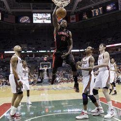 Toronto Raptors' Amir Johnson (15) dunks during the first half of an NBA basketball game against the Milwaukee Bucks Monday, April 23, 2012, in Milwaukee.