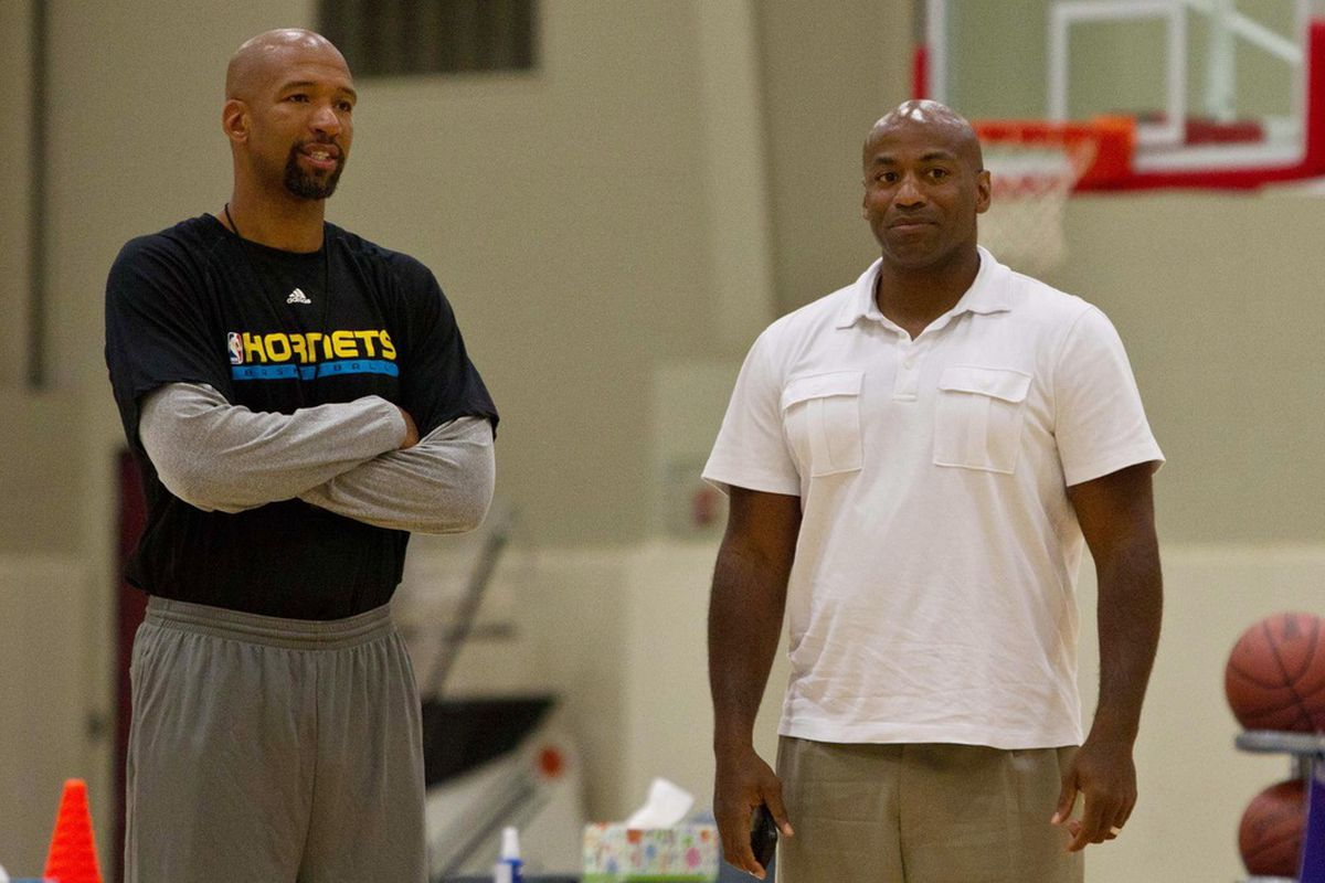 June 4, 2012; Westwego, LA, USA; New Orleans Hornets head coach Monty Williams and general manager Dell Demps watch prospects during a pre-draft workout at the Alario Center.  Mandatory Credit: Derick E. Hingle-US PRESSWIRE