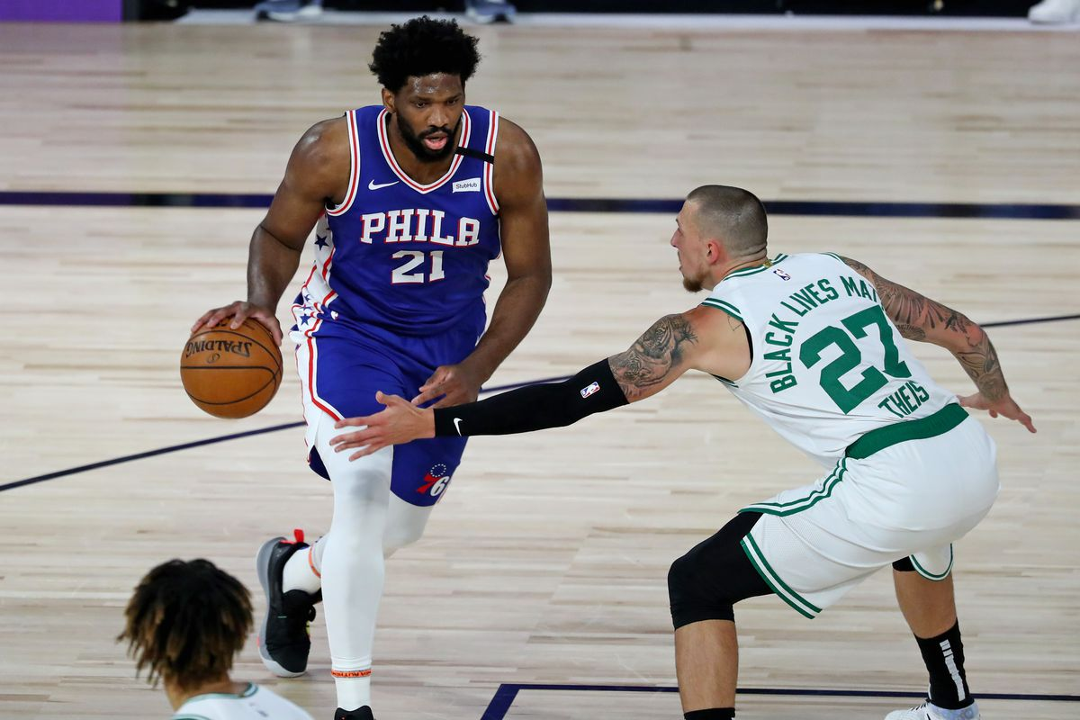 Joel Embiid of the Philadelphia 76ers drives against Daniel Theis of the Boston Celtics during the first half in Game Three of the first round of the NBA Playoffs at The Field House at ESPN Wide World Of Sports Complex on August 21, 2020 in Lake Buena Vista, Florida.