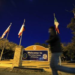 Pedestrians leave the U.S. Customs and Border Station at the Brownsville Gateway Port of Entry in Brownsville, Texas, on Monday, Feb. 22, 2021.