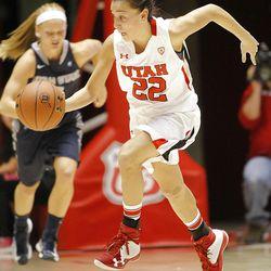 Utah's Danielle Rodriguez pushes the ball up court as Utah and Utah State play Nov. 27, 2012, in the Huntsman Center. Utah won 92-64.