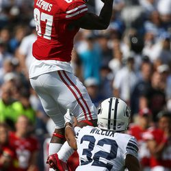 Wisconsin Badgers wide receiver Quintez Cephus (87) jumps to receive a pass above Brigham Young Cougars defensive back Chris Wilcox (32) during the game at LaVell Edwards Stadium in Provo on Saturday, Sept. 16, 2017.