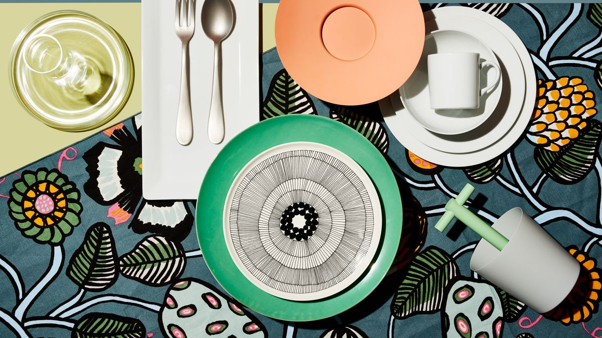 An assortment of dishes spread on a floral tablecloth.