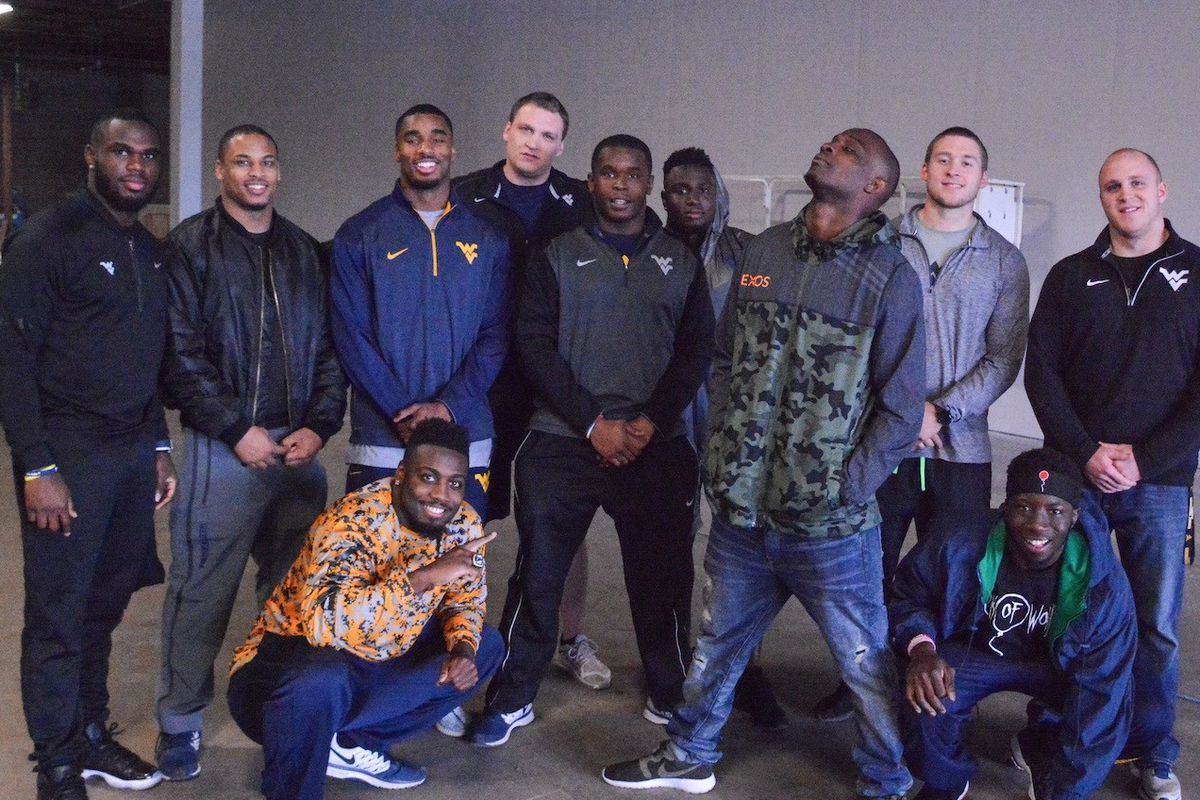Former Mountaineers gather together before a Fan Day Autograph session