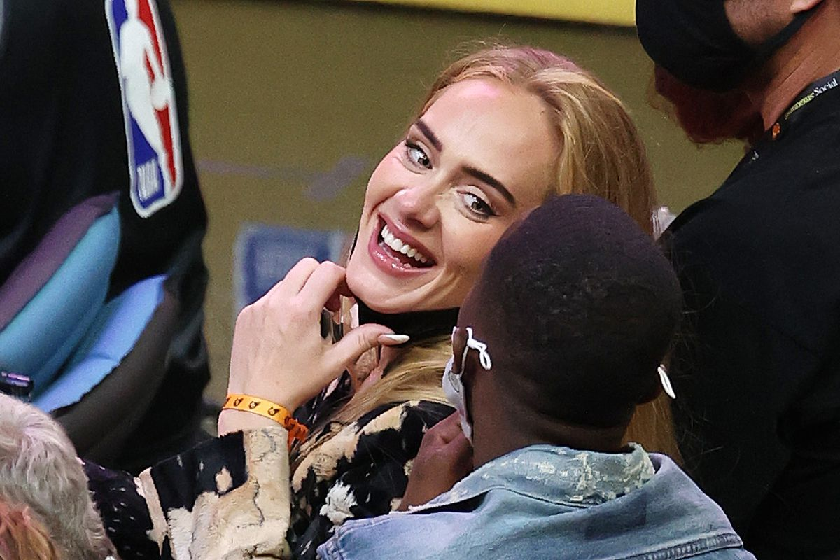 Singer Adele smiles with Rich Paul during the second half in Game Five of the NBA Finals between the Milwaukee Bucks and the Phoenix Suns at Footprint Center on July 17, 2021 in Phoenix, Arizona.